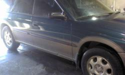 """15"""" Subaru Rims + 205 70 15 Goodyear all season tires"""