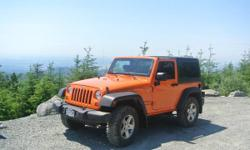 2012 Orange Crush 2DR Jeep Wrangler Sport S